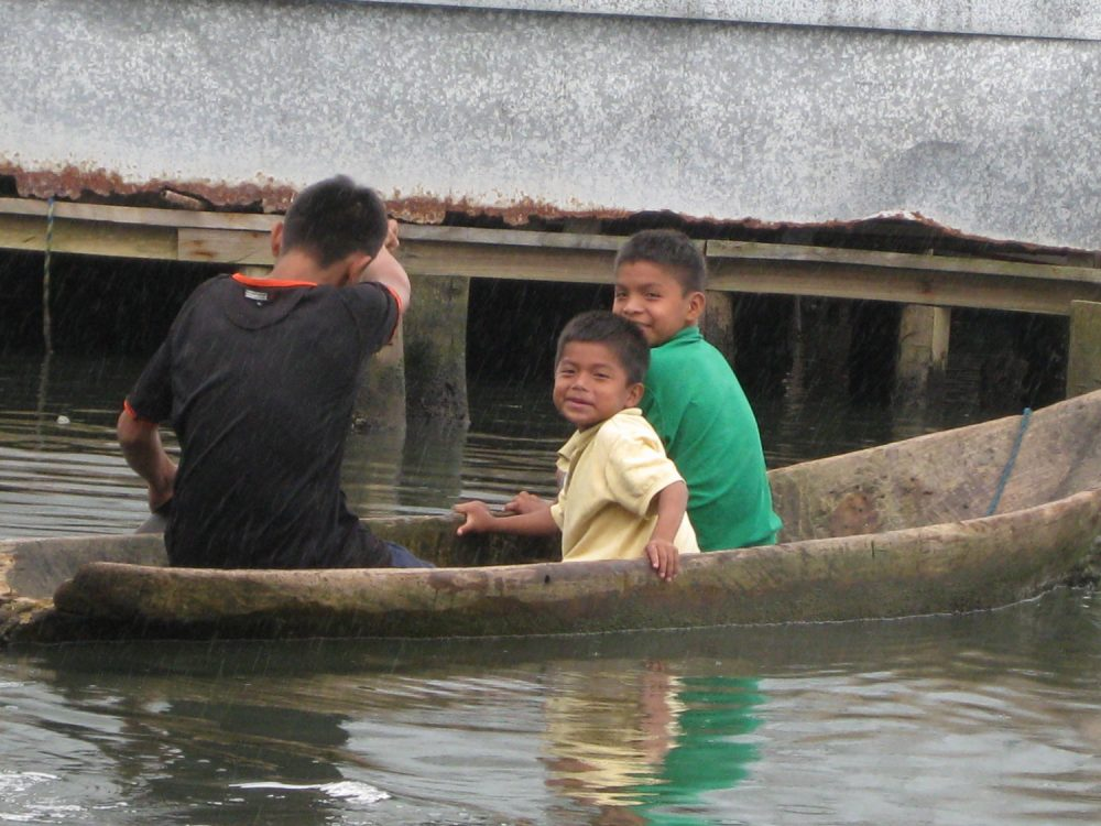 Panama kids in canoe